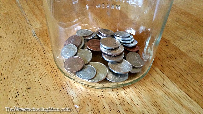 Teach your kids about money with the Spare Change game - The Hmmmschooling Mom